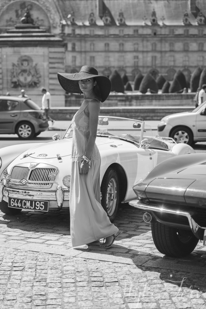 woman with vintage car in paris