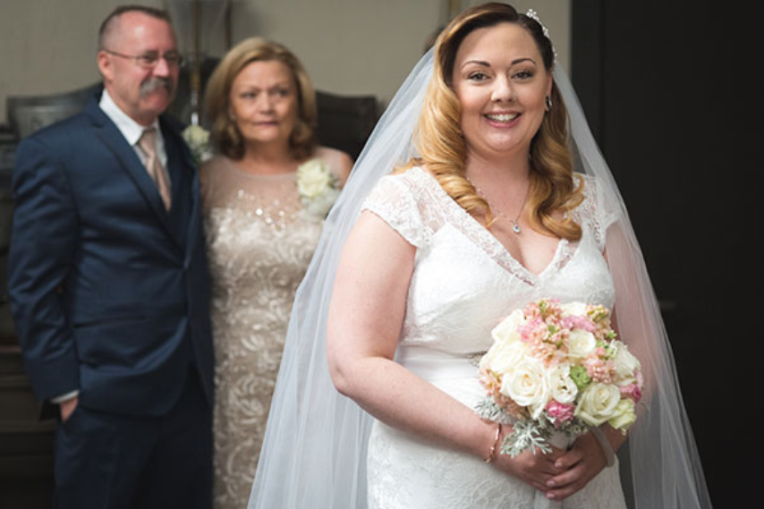 Emotional First Look with Parents in Squall Valley: Featured in Bridal Guide Magazine